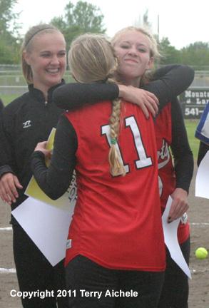 left claire ely of westonmcewen hugs a teammateimg
